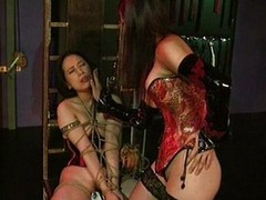 Domme disciplines her thrall