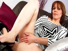 MILF with hirsute wet crack masturbates