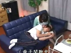 Japanese stepmom drilled by son behind father.