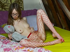 Nerdy and brave legal age teenager connected with fishnet nylons is showing her kitty