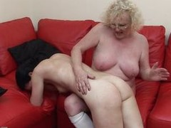 This granny has the younger woman on her knee, but if u are thinking that this babe is going to lack any sexuality, U have to think another time as this babe lures the younger woman betwixt her legs and widens her large legs wide open for younger woman. Apparently the darksome haired woman loves what this babe finds there.