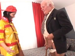 Brunette hair playgirl in firefighter uniform receives screwed by old beggar