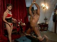 Domina Bobbi Starr tortures one of her slaves