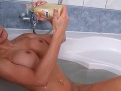 Fake titty Jasmine Jae masturbates in the tub