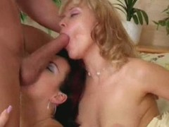 Redhead and blond take turns engulfing a bushwa